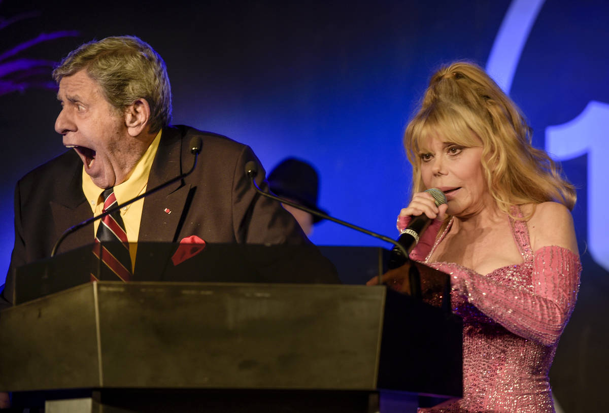 Casino Entertainment Legend Award winner Jerry Lewis, left, and Charo joke with the crowd at th ...