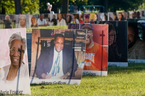 Some of the nearly 900 poster-sized photos of Detroit victims of COVID-19 are displayed on Bell ...