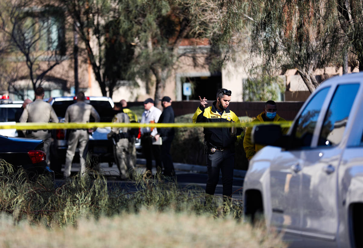 Police investigate the scene of a homicide on the 3900 block of West Cheyenne Avenue on Tuesday ...