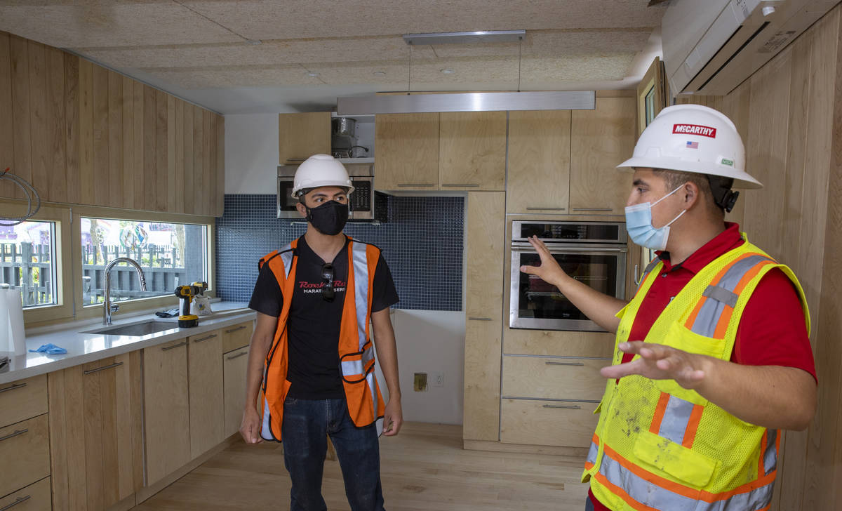 Students Alejandro Munoz, right, and Miguel Vazquez talk about the work left to do in the kitch ...