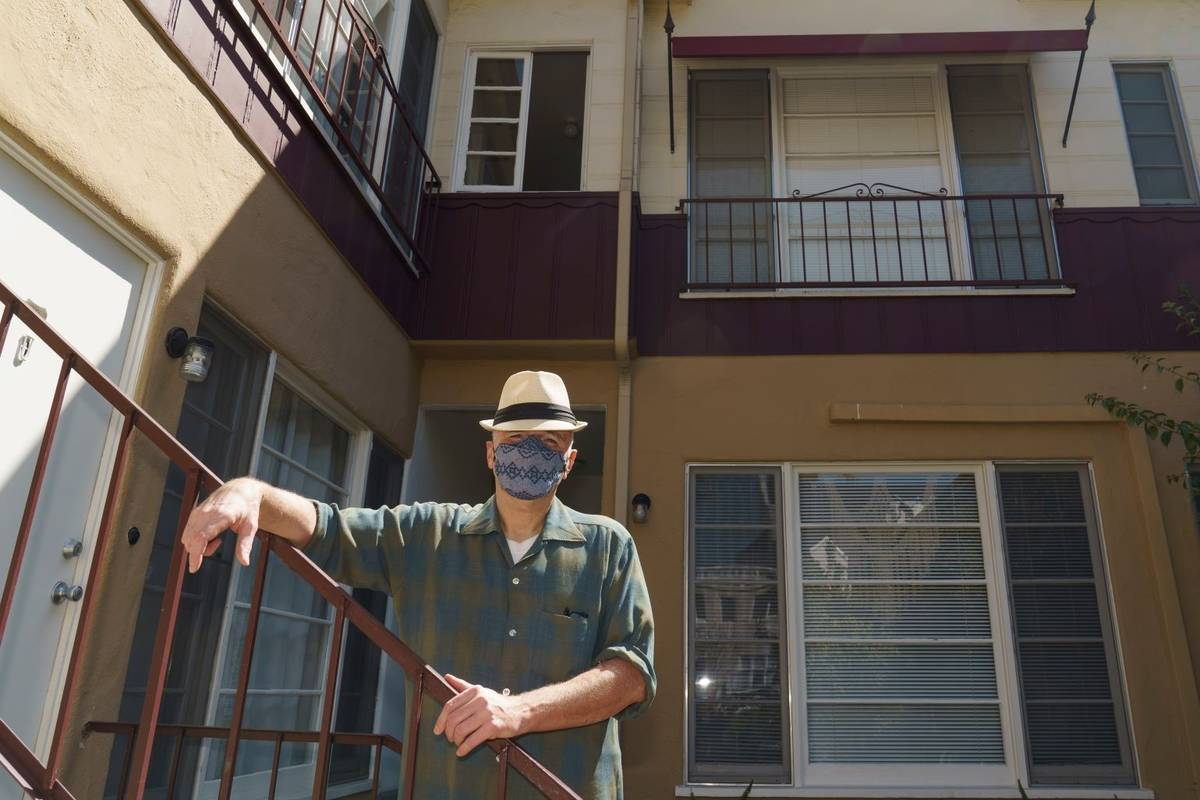 Nathan Long, a video game writer, poses for a picture outside his rental apartment courtyard in ...