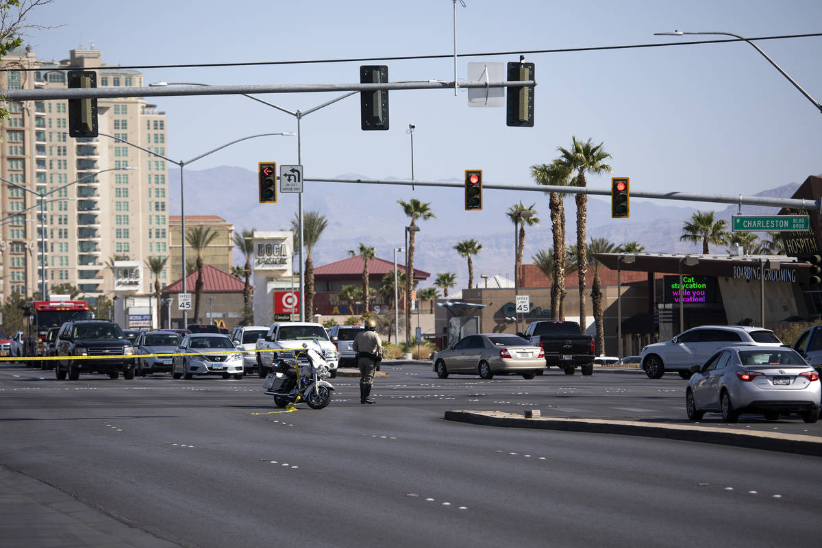 South Fort Apache Road is blocked off while homicide detectives investigate after a woman's bod ...