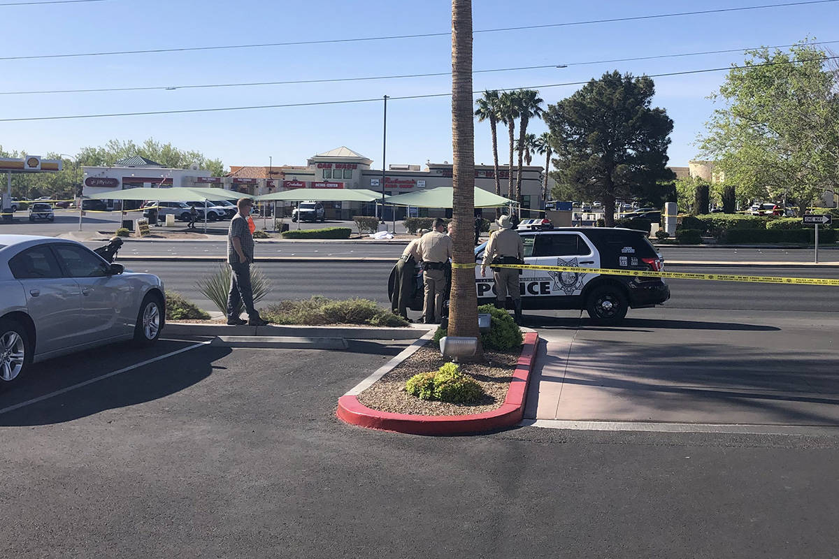 Police investigate a report of a body found Saturday, April 10, 2021, at West Charleston Boulev ...