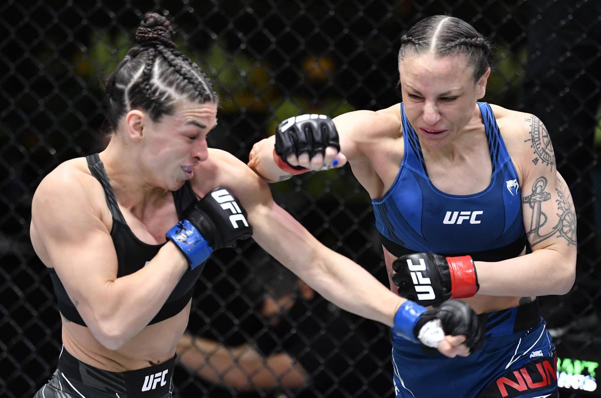 LAS VEGAS, NEVADA - APRIL 10: (R-L) Nina Nunes battles Mackenzie Dern in a strawweight fight du ...