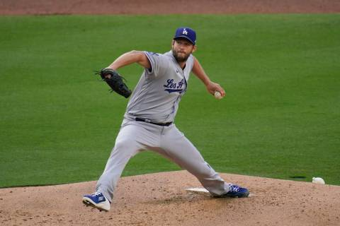Los Angeles Dodgers starting pitcher Clayton Kershaw works against a San Diego Padres batter du ...