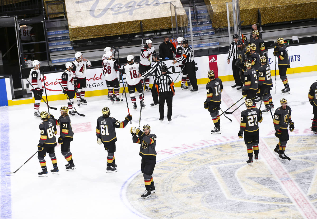The Golden Knights celebrate after a shutout win over the Arizona Coyotes in an NHL hockey game ...