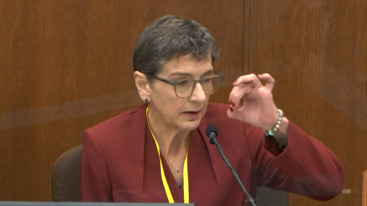 In this image from video, Dr. Lindsey Thomas, a forensic pathologist, now retired, testifies as ...