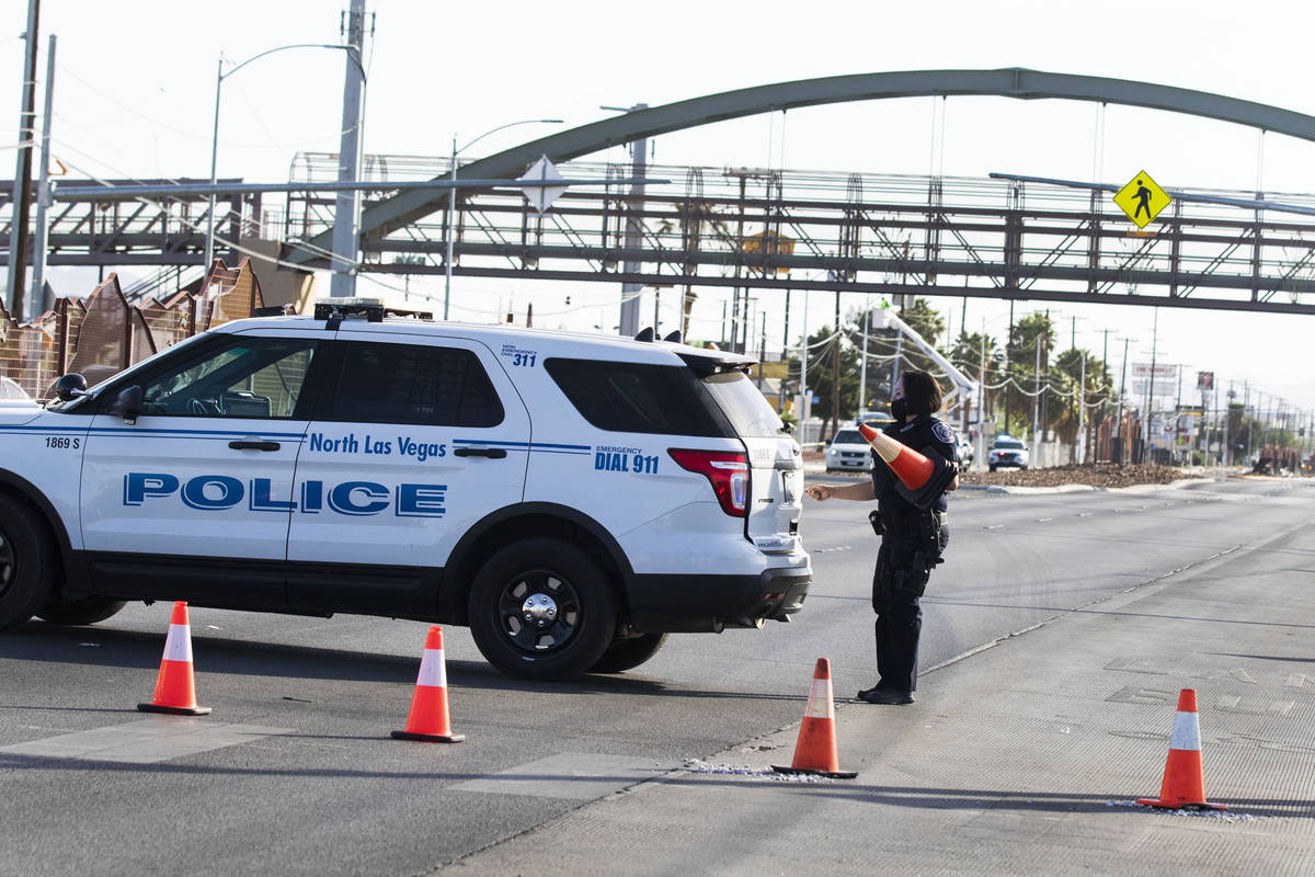North Las Vegas police are investigating the death of a man found near a bus stop along Las Veg ...