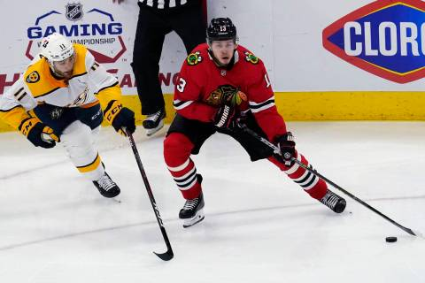 Chicago Blackhawks center Mattias Janmark, right, is defended by Nashville Predators center Luk ...