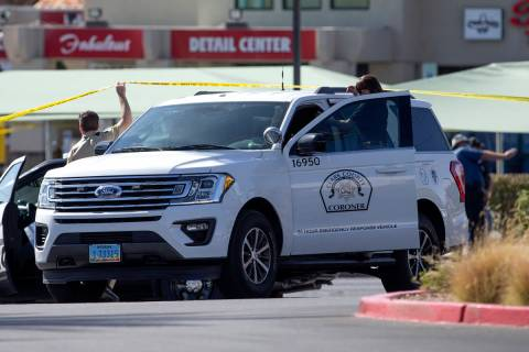The Clark County Coronor leaves a scene where homicide detectives are helping to investigate af ...