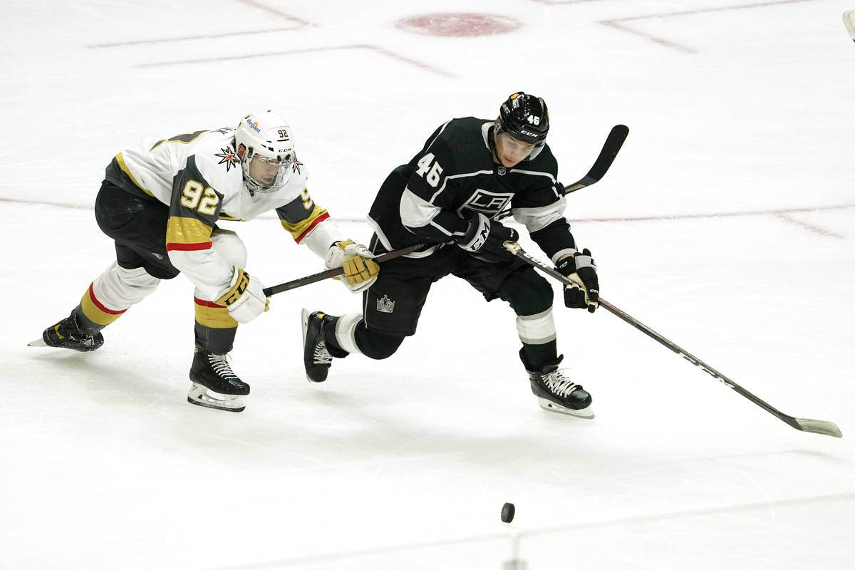 Vegas Golden Knights left wing Tomas Nosek, left, and Los Angeles Kings center Blake Lizotte ba ...