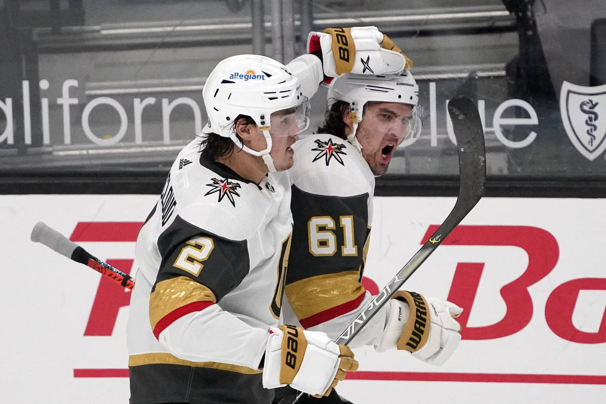 Vegas Golden Knights right wing Mark Stone, right, celebrates his goal with defenseman Zach Whi ...