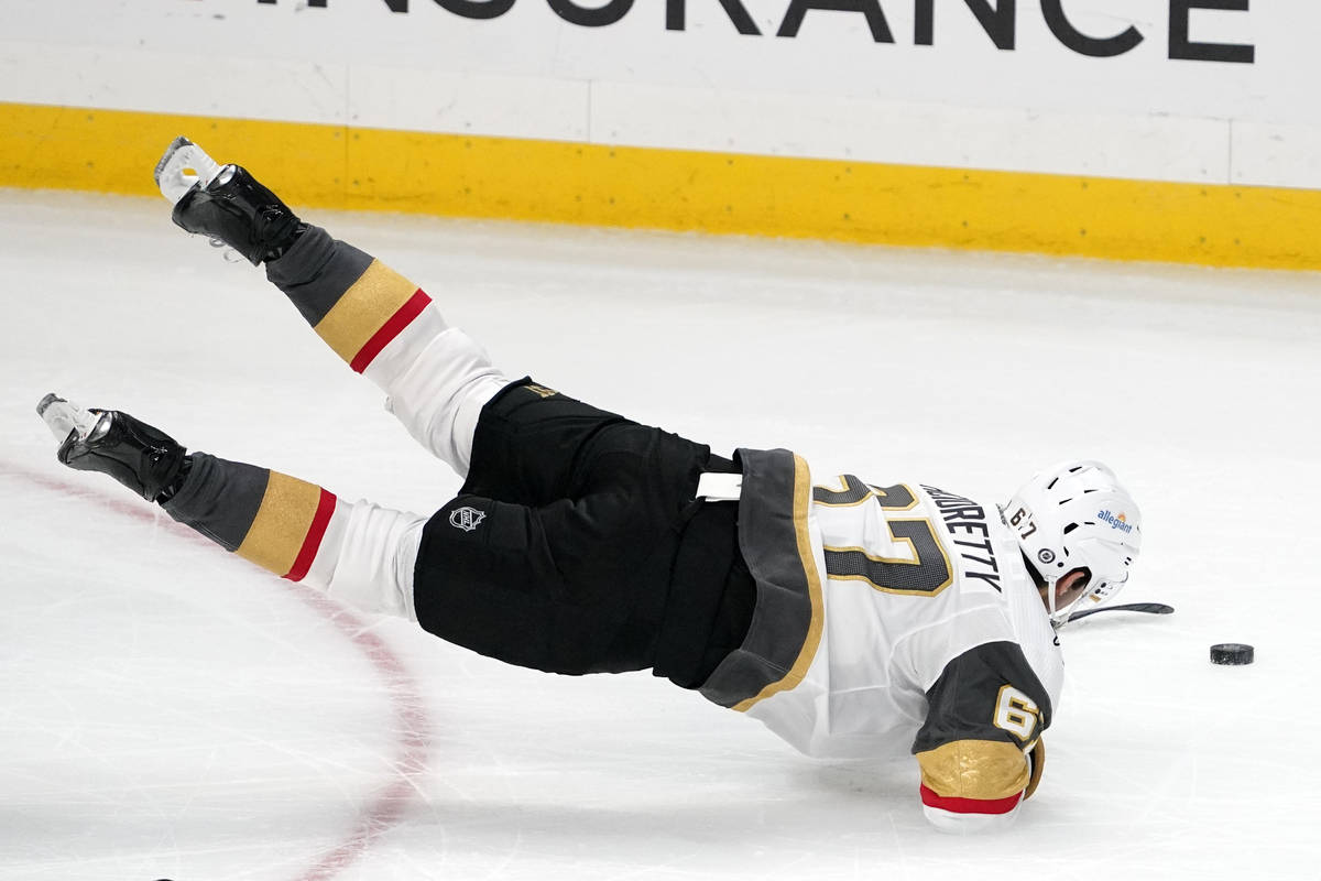Vegas Golden Knights left wing Max Pacioretty trips as he moves the puck during the third perio ...