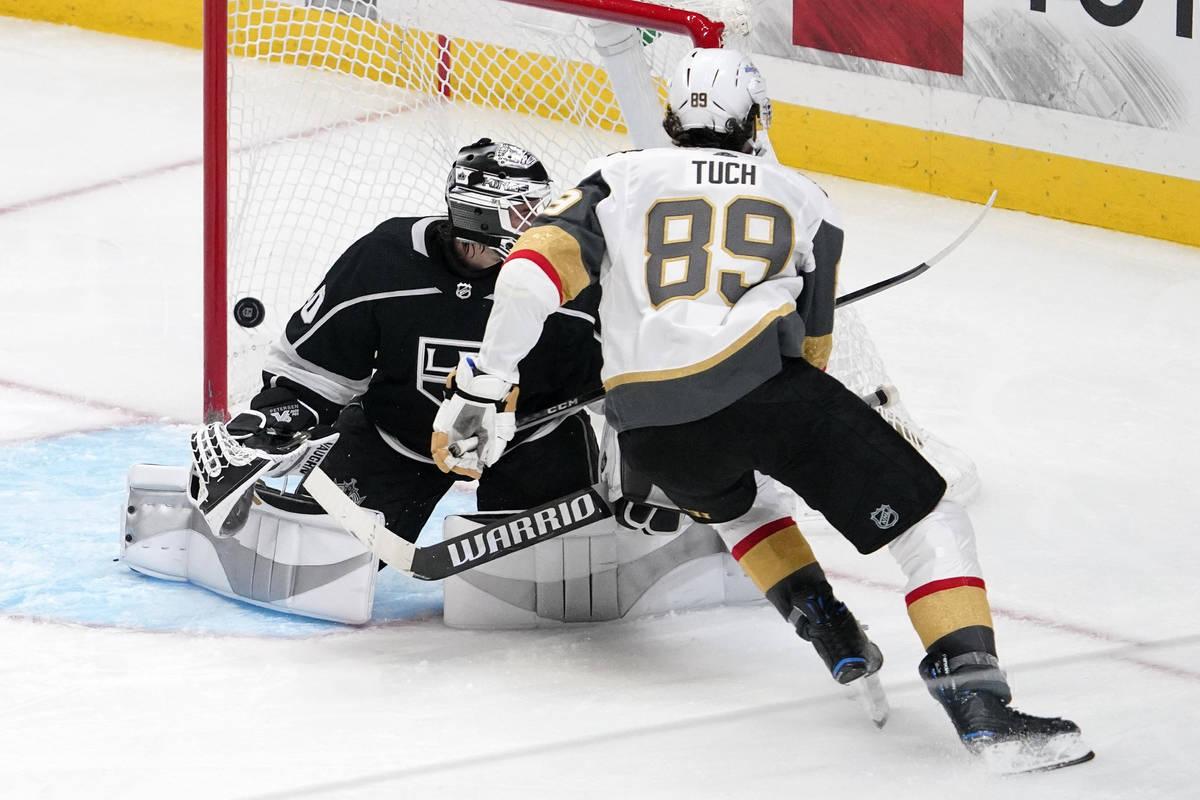 Vegas Golden Knights right wing Alex Tuch, right, scores on Los Angeles Kings goaltender Calvin ...