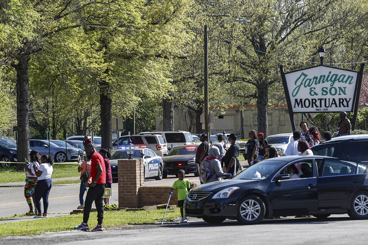 People gather outside Austin-East Magnet High School in Knoxville, Tenn., following a shooting ...