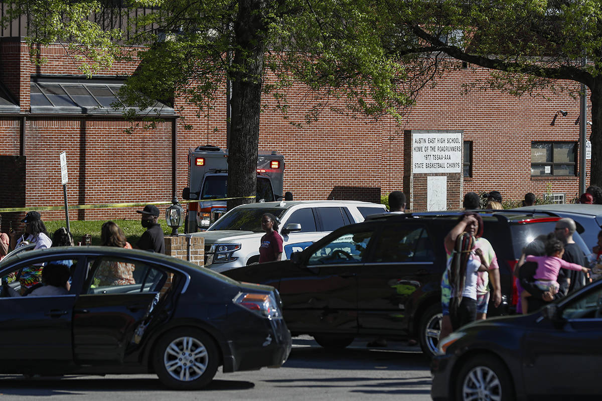 People gather outside Austin East High School in Knoxville, Tenn., as Knoxville police work the ...