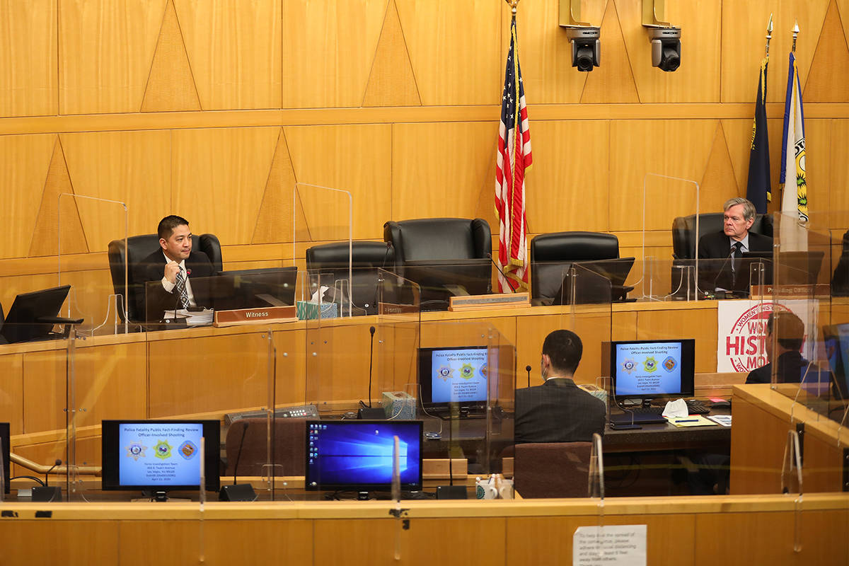 Las Vegas police Detective Scott Mendoza, left, speaks at a fact-finding review on March 10, 20 ...