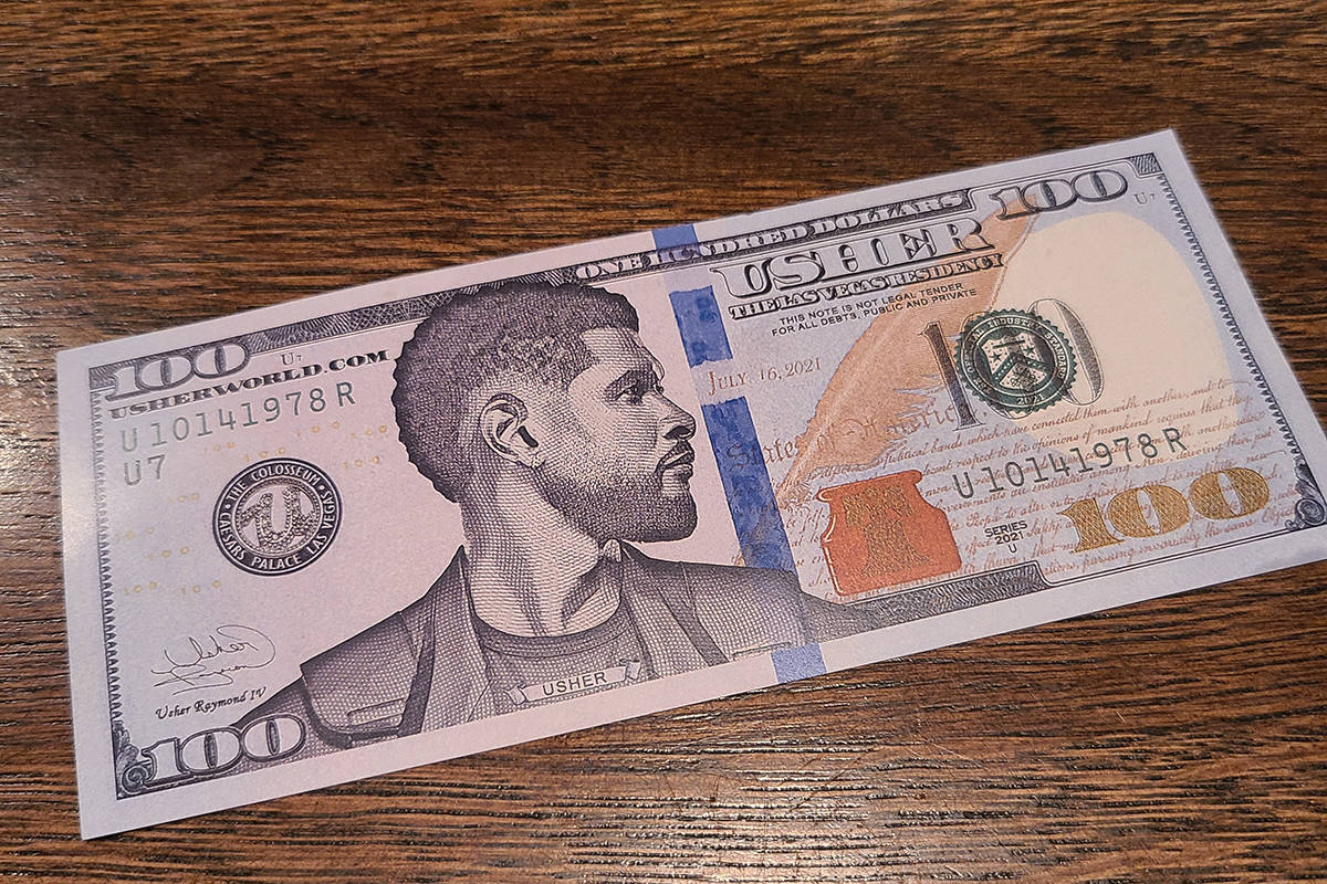 Usher's commemorative $100 bill is shown at Esther's Kitchen in the Arts District on Tuesday, M ...