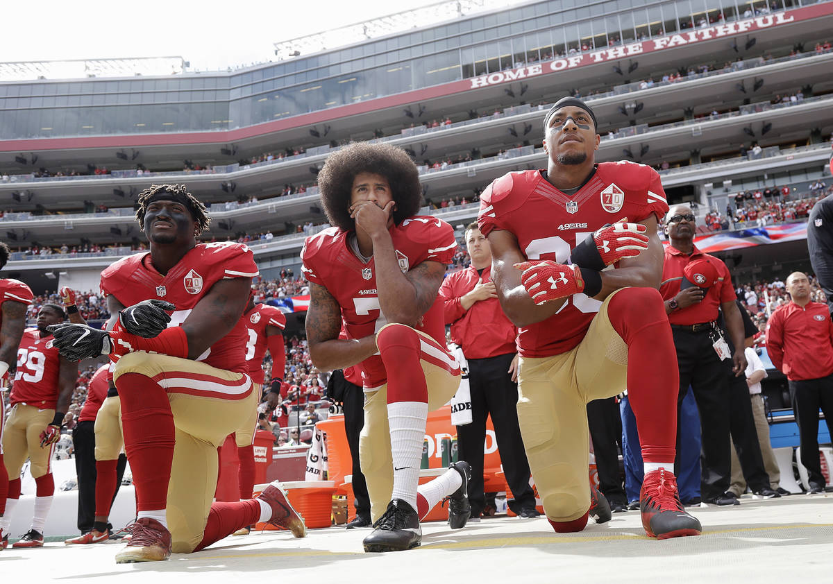 FILE - In this Oct. 2, 2016, file photo, from left, San Francisco 49ers outside linebacker Eli ...