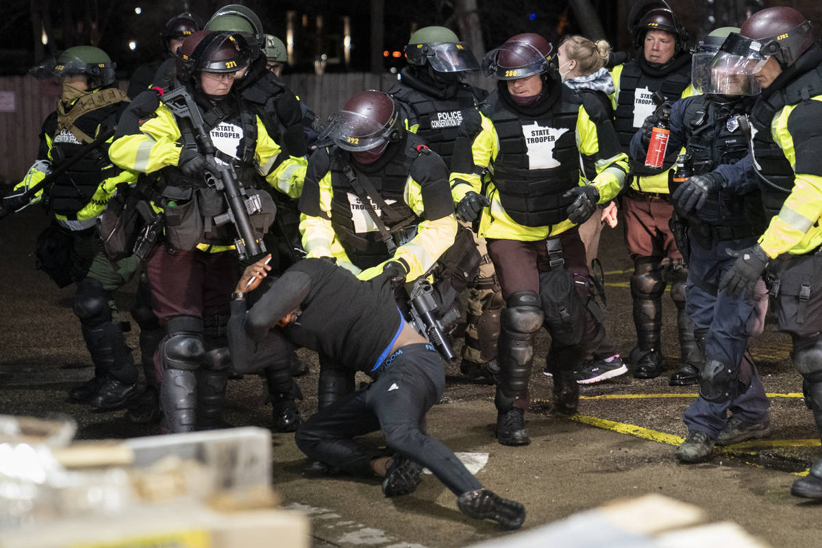 A demonstrator is arrested by police for violating curfew and an order to disperse during a pro ...