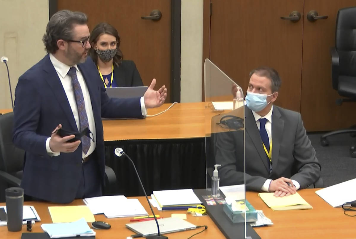 In this image from video, defense attorney Eric Nelson, left, discusses motions before the cour ...
