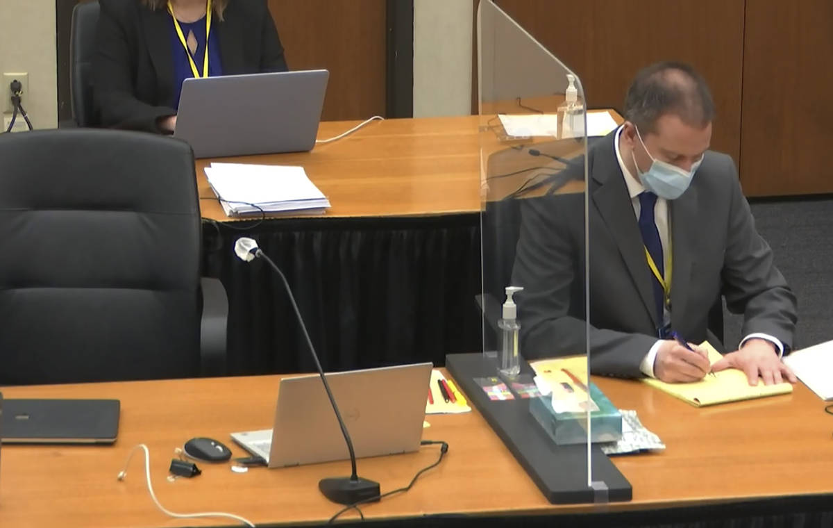 In this image from video, defendant, former Minneapolis police officer Derek Chauvin, right, ta ...