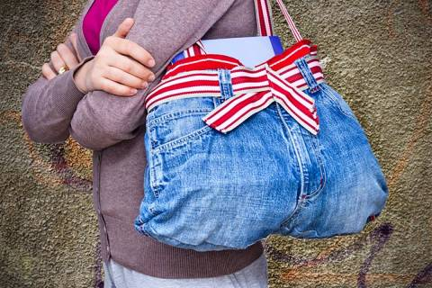 "An old pair of woman's jeans converted into a handbag is an example of ""upcycling."" (Getty Images)"