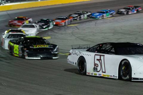 NASCAR star Kyle Busch turns the corner during the Star Nursery 100 Super Late Model feature ra ...