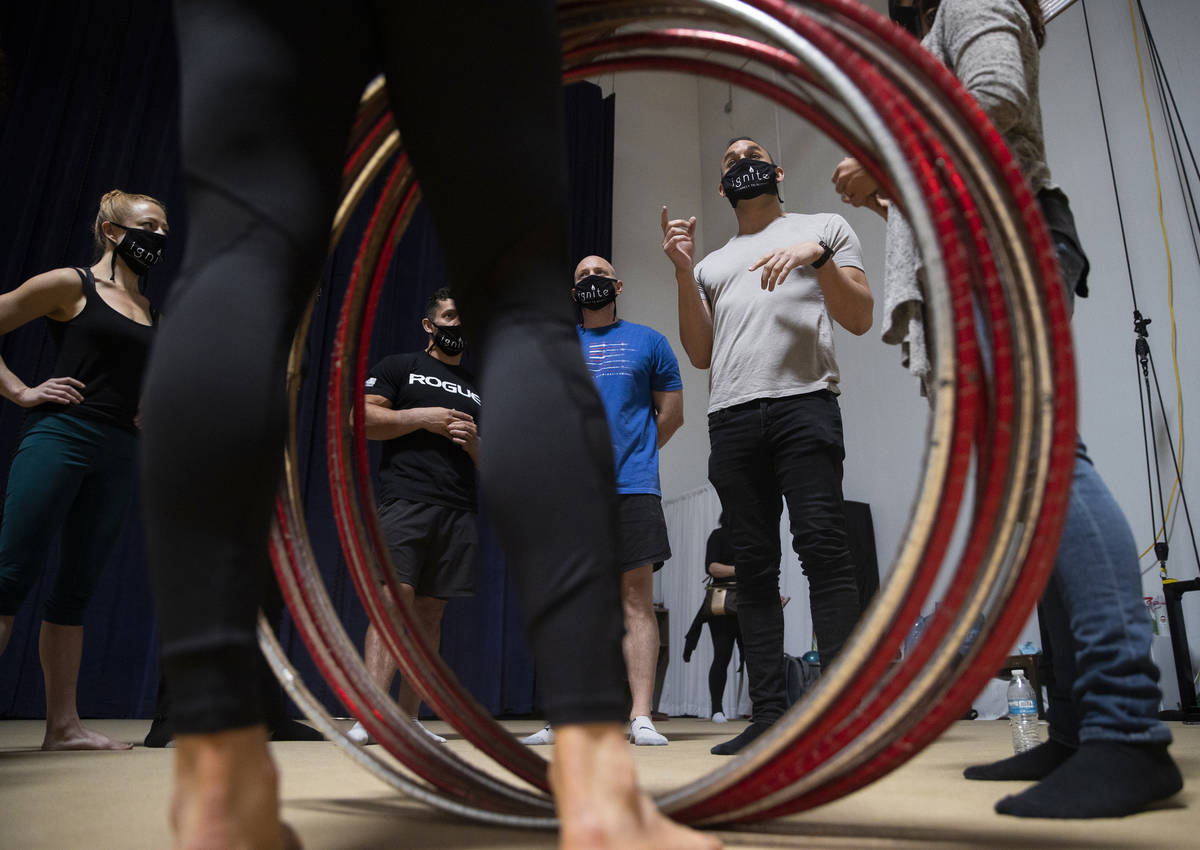 """Brandon Pereyda, second from right, leads a meeting during rehearsal for """"Ignite"""" at Nevada Rhy ..."""