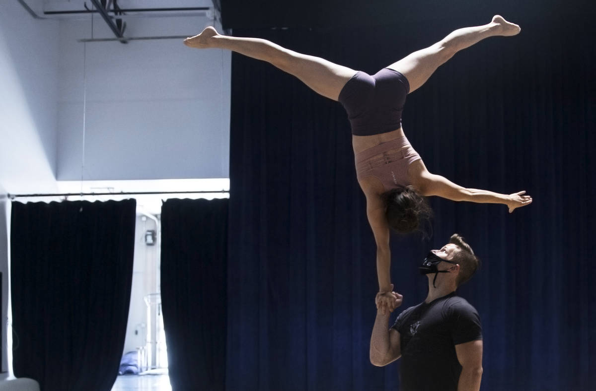 """Hand to hand acrobatic duo Marie-Lee Guilbert, top/left, and Philippe Blanger rehearse for """"Ign ..."""
