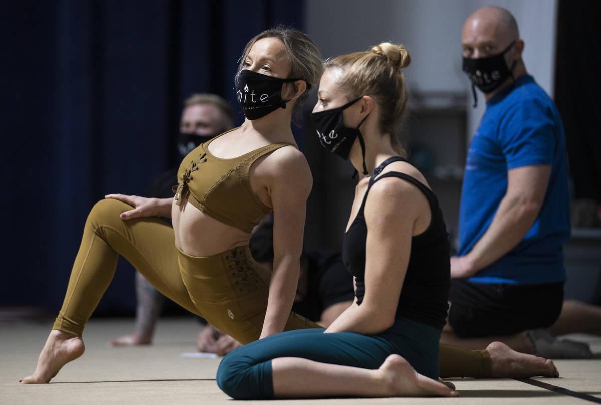 "Acro-girls Anna Melnikova, left, and Kerren McKeeman stretch during rehearsal for ""Ignite"" at N ..."