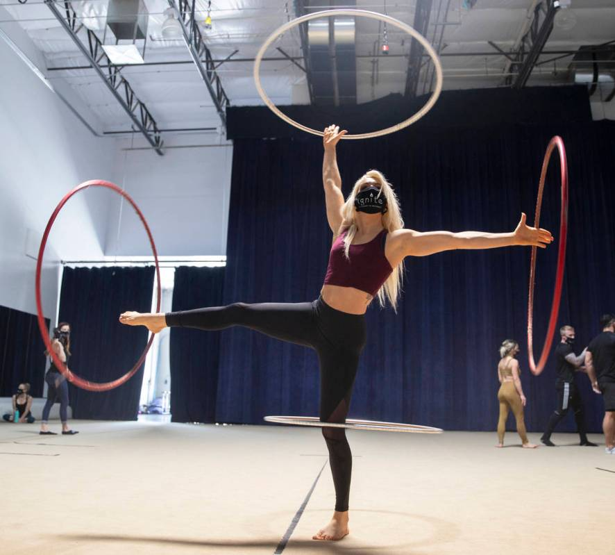 """Hula hoop performer Grace Good rehearses for """"Ignite"""" at Nevada Rhythmic Academy on Thursday, A ..."""