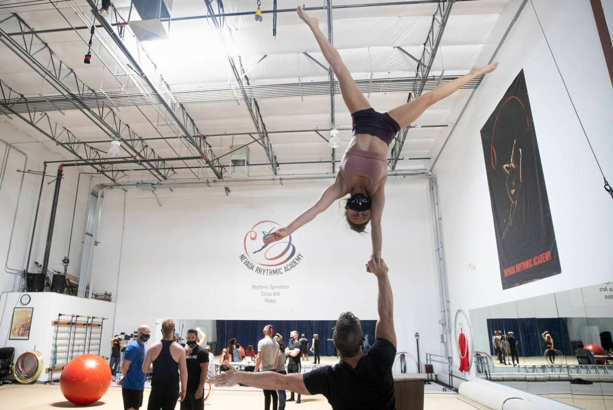 """Hand to hand acrobatic duo Marie-Lee Guilbert, top/right, and Philippe Blanger rehearse for """"Ig ..."""