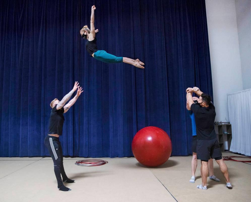 Banquine acrobats Barnaby Llewellyn, left, Kerren McKeeman, Adam Laughton and Adam Denny rehear ...