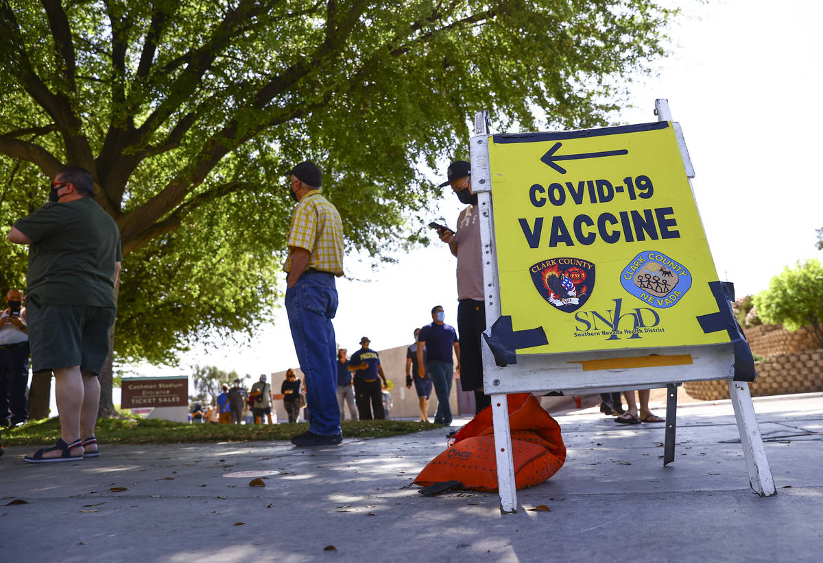 People wait in line at the COVID-19 vaccination site at Cashman Center in Las Vegas on Tuesday, ...