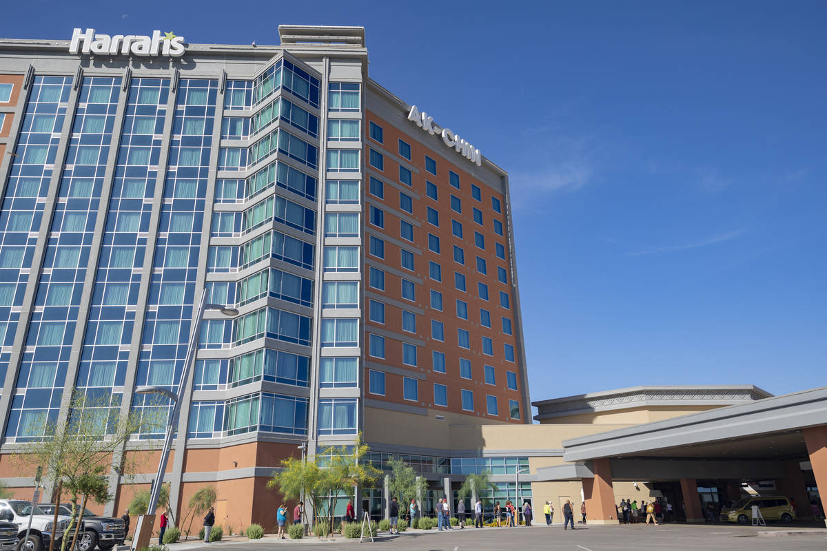 A line forms for the reopening of Harrah's Ak-Chin Casino in Maricopa, Ariz. on Friday, May 15, ...