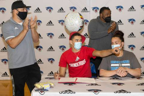 Desert Pines senior Anthony Swift, second from left, sits next to his mother Jay Douwes, and co ...