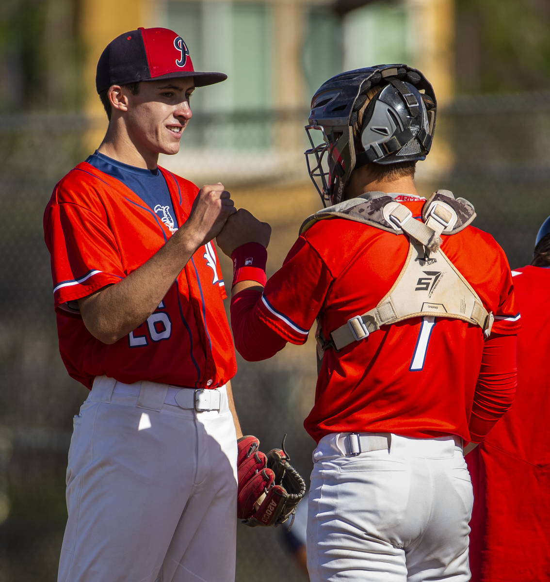 Liberty pitcher Ethan O'Neal (26) is encouraged by catcher Chase Gallegos versus Spring Valley ...
