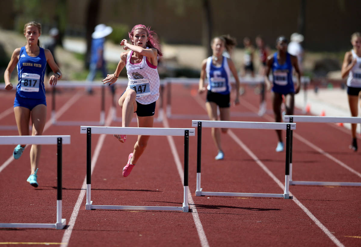 Quincy Bonds Centennial, second from left, on her way to winning Class 4A 300 meter hurdles in ...