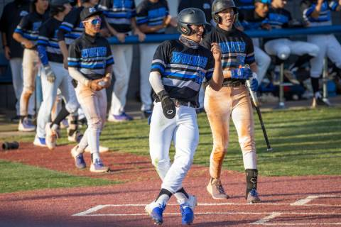 BasicÕs Hunter Katschke (10) scores a run and closes the extra innings gap to one run vers ...