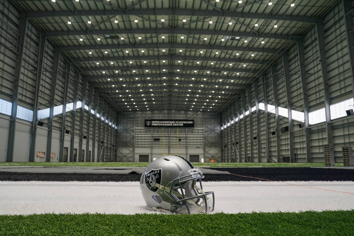 A Raiders helmet sits in one of the end zones in the field house of their Intermountain Healthc ...