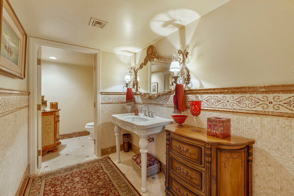 A powder room near the foyer. (Fraser Almeida/Luxury Homes Photography)