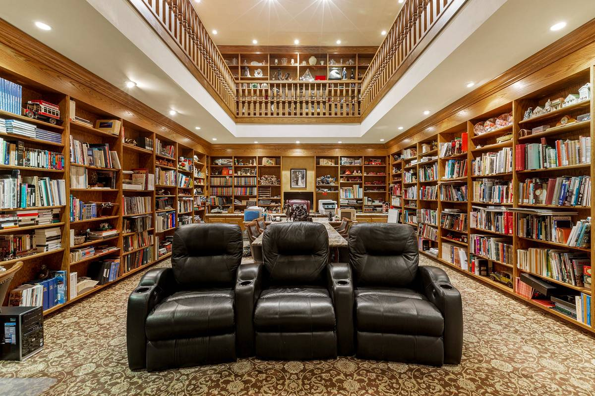 What had been a racquetball court has been converted into a two-story office in the basement. A ...