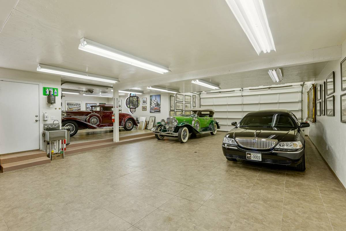 A six-car attached garage is augmented by a separate garage area that accommodates two more car ...