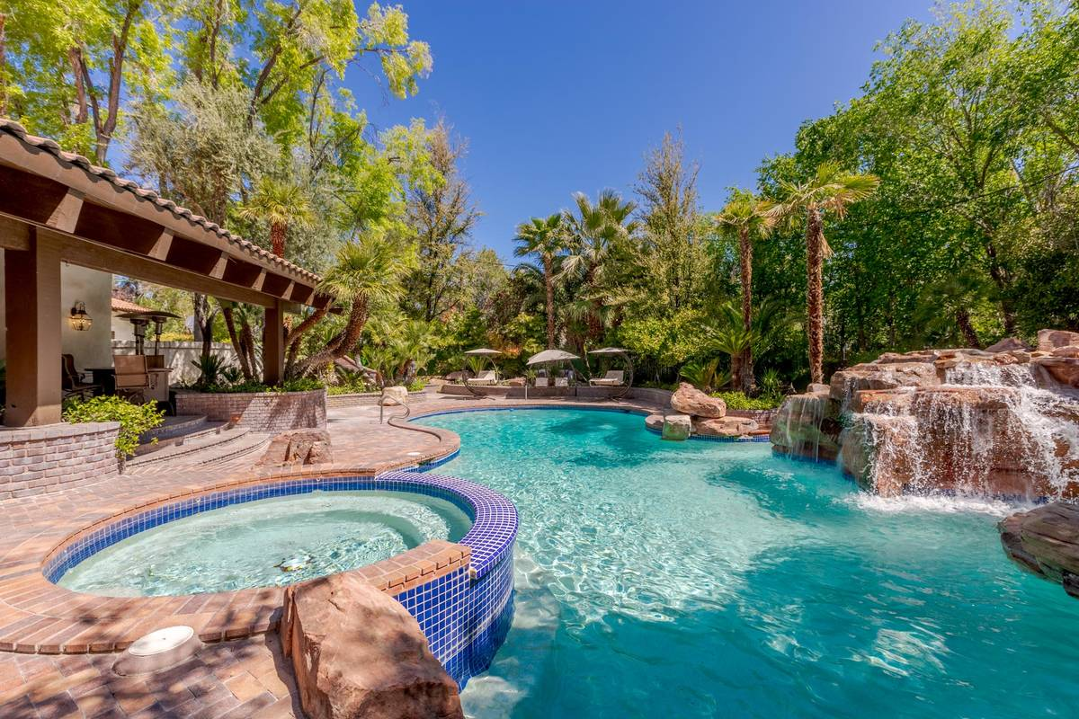 The property's amenities include a resort pool and waterfall. (Fraser Almeida/Luxury Homes Phot ...
