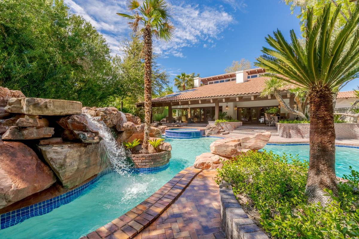 The yard includes a resort pool/spa and waterfall with mature landscaping. (Fraser Almeida/Luxu ...