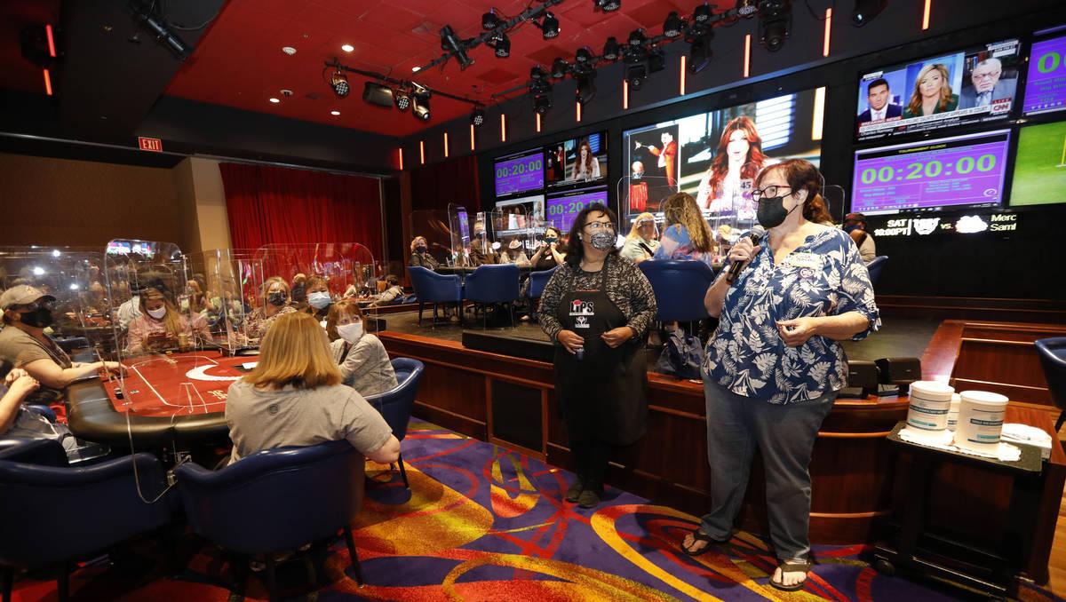 Linda Johnson, co-host of 2021 Nevada State Ladies Poker Championship, right, speaks before $17 ...