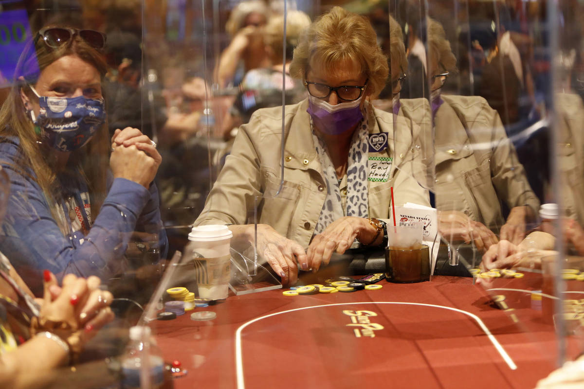 Pam Kocsis of Fresno, Calif., left, and Bay Haught of Chappell Hill, Texas, right, play in $175 ...
