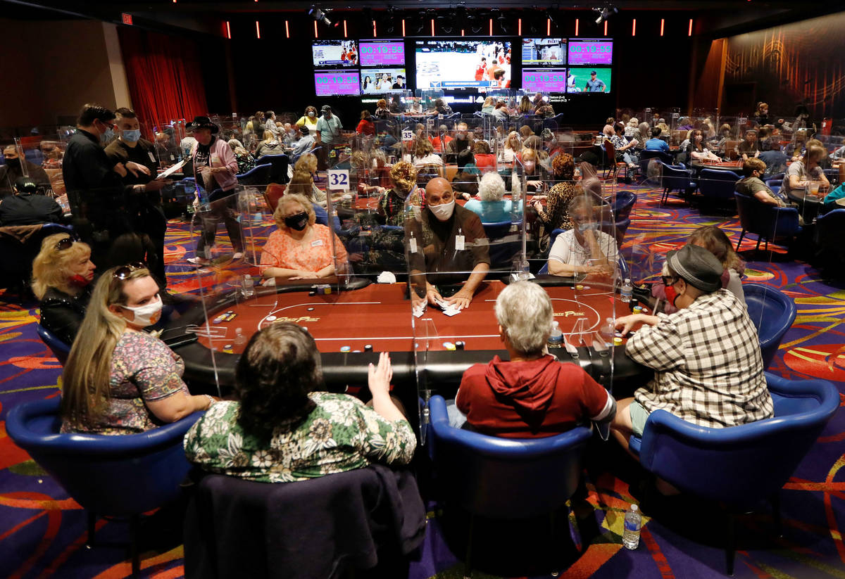 Dealer Joey Molinario, center, shuffles cards as women play in $175 No-Limit Hold'em Ladies tou ...