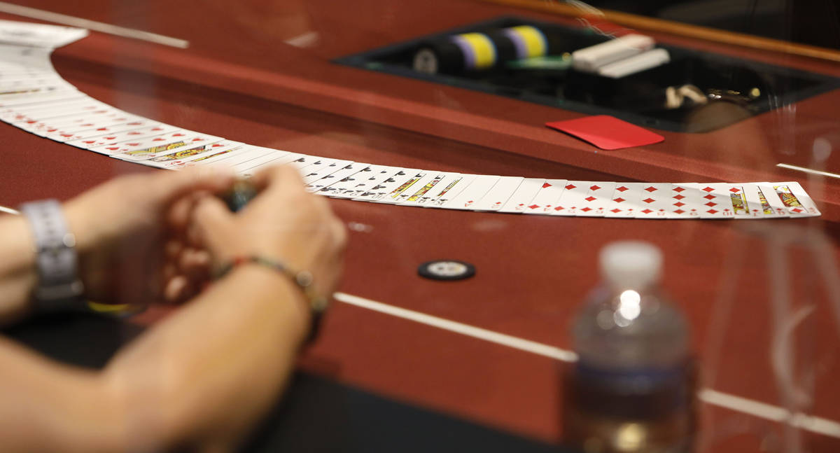 A player watches cards in $175 No-Limit Hold'em Ladies tournament during 2021 Nevada State Ladi ...